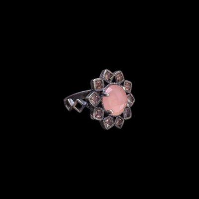 Anillo Enigma de plata y cuarzo rosa Flor